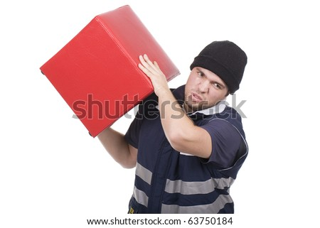 man carrying an heavy and red cube - stock photo
