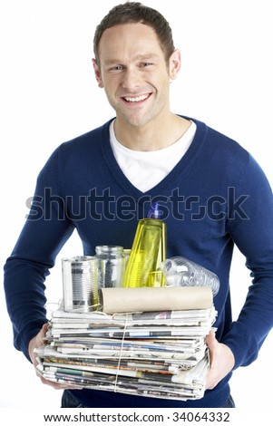 Man Carrying Stack Of Recycling - stock photo