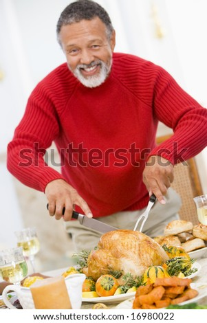 Man Carving Roast Chicken - stock photo