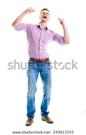 Man celebrating with hands raised - Full length portrait of a very happy young man, isolated on white background  - stock photo
