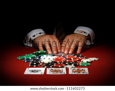man cheating when playing cards - stock photo