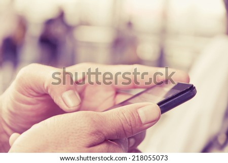man checking his phone - stock photo