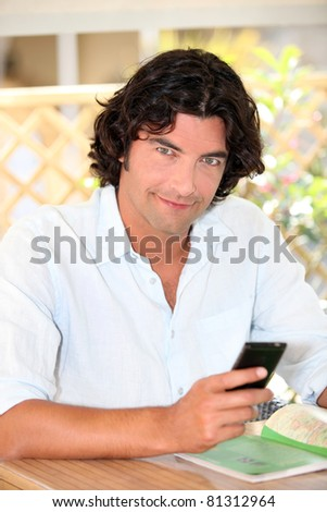Man checking his phone for messages - stock photo