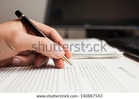 Man checking text on a document - stock photo