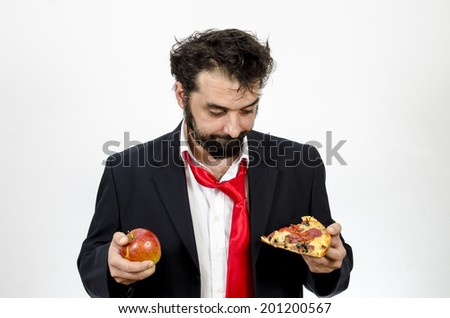 Man Choosing Between An Apple Or A Slice Of Pizza - Healthy Food Versus Unhealthy Food - Isolated On White / Man Choosing Between Snacks - stock photo