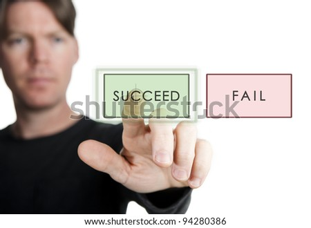 """man choosing to press the """"succeed""""button instead of the """"fail"""" button - stock photo"""