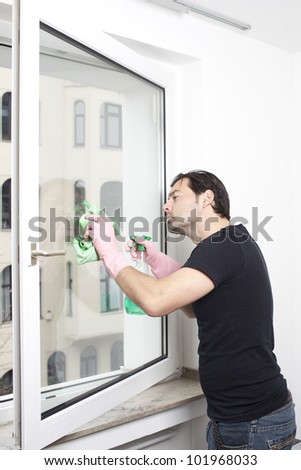 Man cleaning a window - stock photo