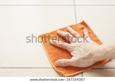 man cleaning the dust on the floor  - stock photo