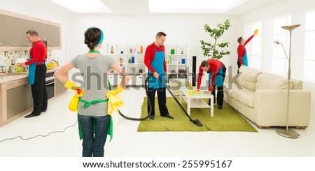 man cleans house in different places at the same time while woman supervise progress - stock photo
