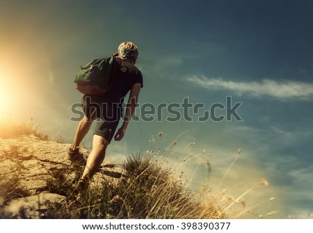 Man climb on mountain hill - stock photo