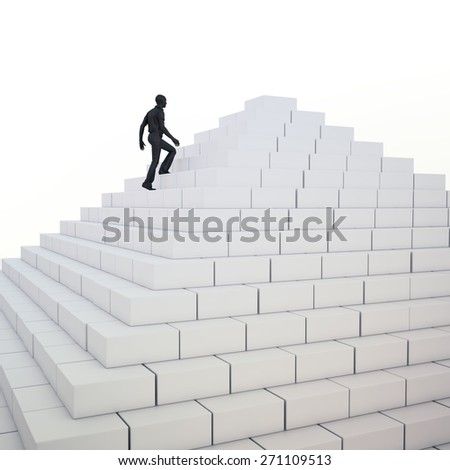 Man climbing a pyramid - stock photo