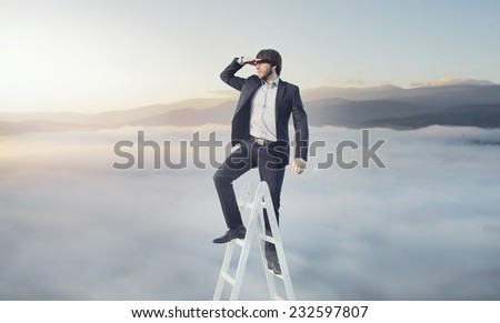 Man climbing career ladder - stock photo
