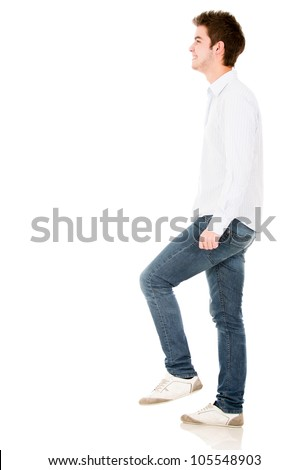Man climbing imaginary stairs - isolated over a white background - stock photo