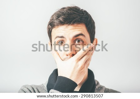 man closed his mouth with his hand - stock photo