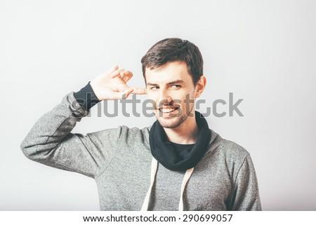 man closes his ear - stock photo