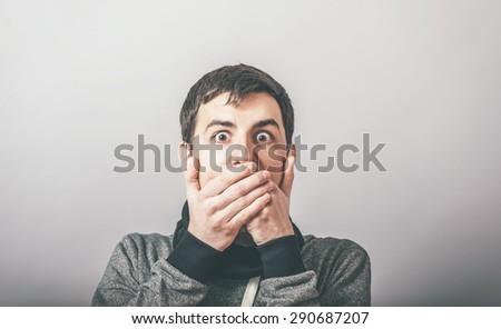man closes his mouth - stock photo