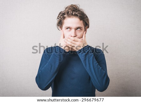 man closes mouth - stock photo