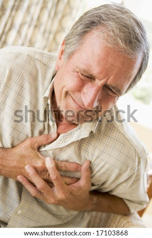 Man Clutching His Heart - stock photo