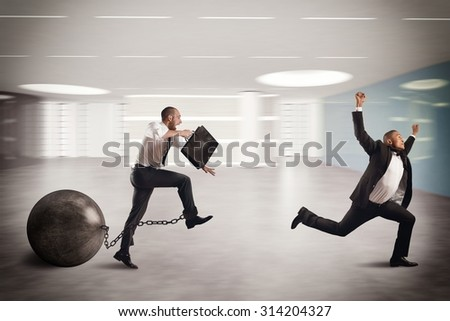Man competing with a man with obstacle - stock photo