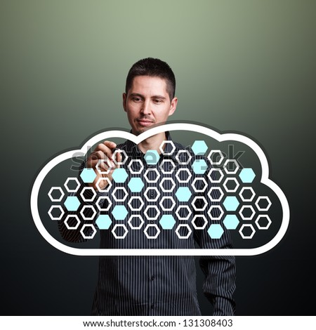 Man completing fields in cloud computing diagram - stock photo