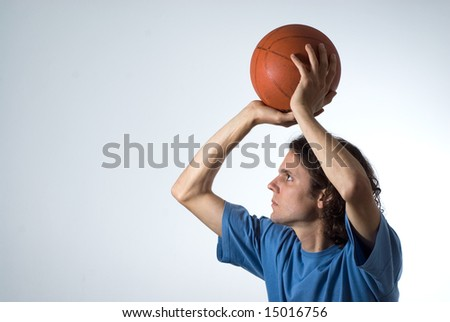 Man concentrating on shooting basketball. Horizontally framed photograph. - stock photo