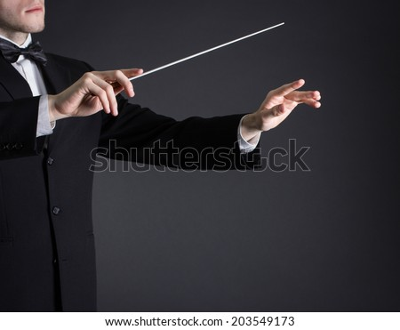 Man conducting an orchestra - stock photo