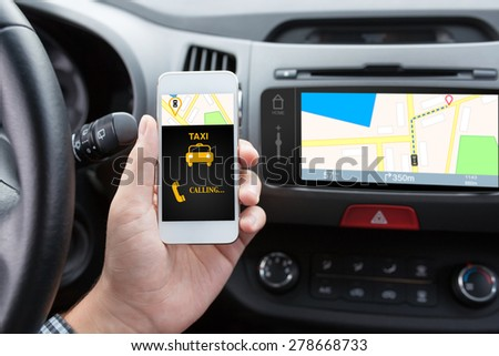 man connecting phone with app taxi in the car and navigation map - stock photo