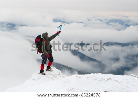 man conquest the peak - stock photo