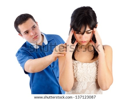 Man consoling his girlfriend after a quarrel. - stock photo