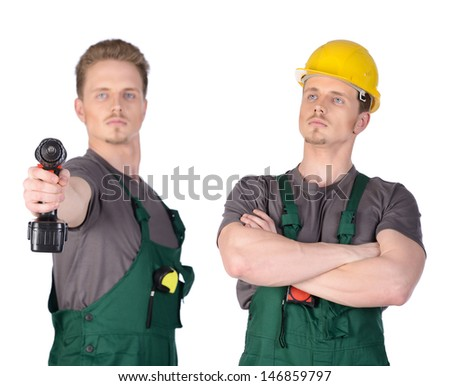 Man construction worker in overalls with electric screwdriver in hand. Isolated on white background. - stock photo