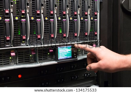 Man controls the rack with a hard drives. - stock photo