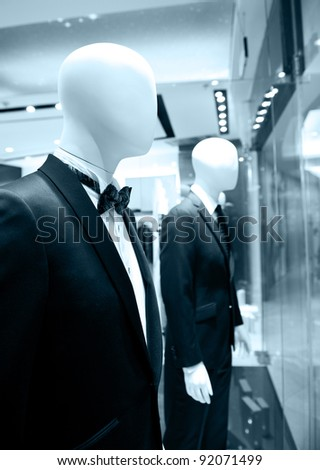 man costumes on shop mannequins - stock photo