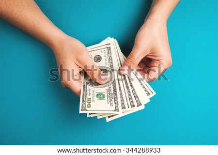 Man counting money, economy concept, allocation of money - stock photo