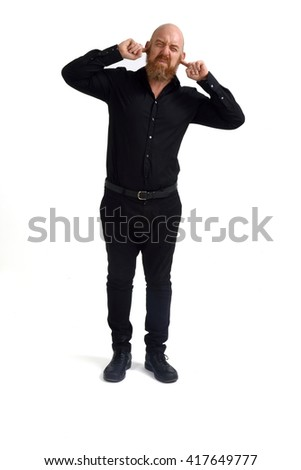 Man covering his ears noise - stock photo