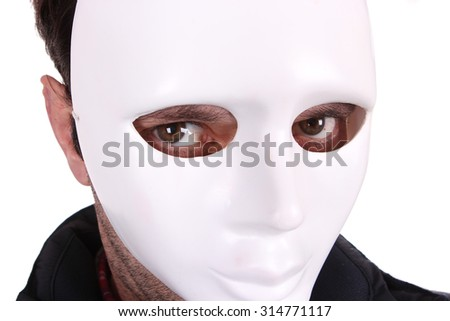 man covering his face with white mask - stock photo