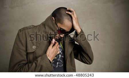 Man covers up and pops his jacket collar - stock photo