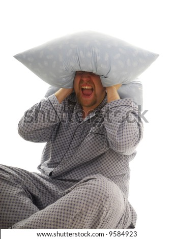 Man cry with pillow on his head - stock photo