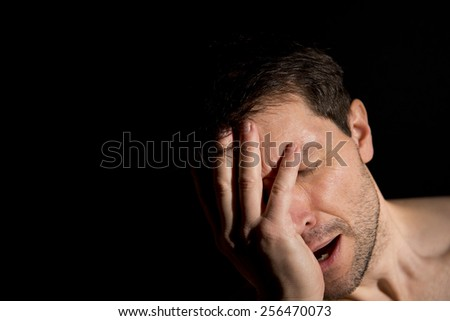 Man Crying Into Hand - stock photo