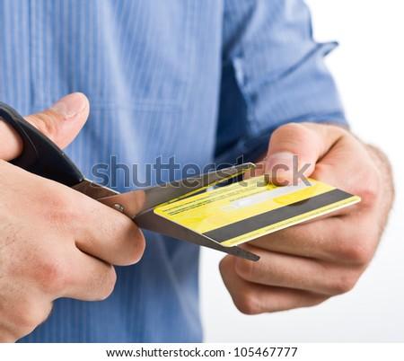 Man cutting a credit card - stock photo