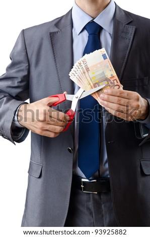Man cutting money on white - stock photo