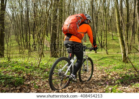 Man cyclist riding the bicycle - stock photo