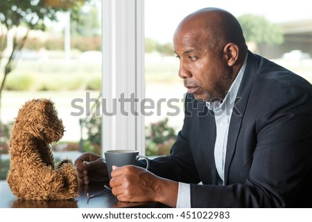 Man dealing with loss and loneliness. - stock photo