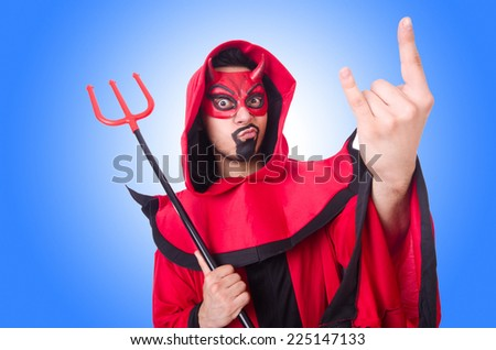 Man devil in red costume - stock photo
