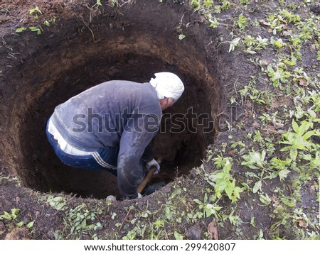 man digs a pit - stock photo