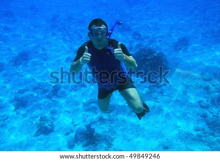 Man diving in Red Sea - Egypt - stock photo