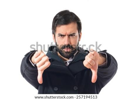 Man doing a bad signal - stock photo