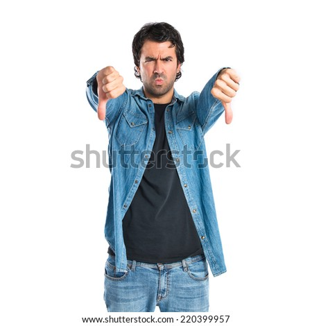 Man doing a bad signal over white background - stock photo