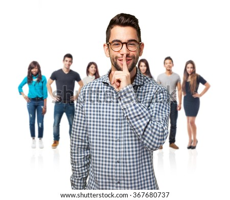 man doing a silence gesture - stock photo