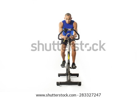 man doing exercise on bike on white background  - stock photo