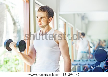 man doing exercises at home or in gym - stock photo